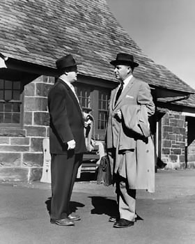 Vintage photo of two men in conversation.