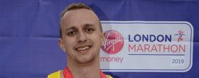 Oliver Stowe showing off his Marathon medal