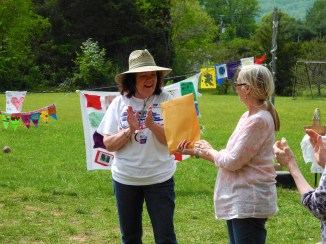 Bonnie giving Amy Kirchner the funds NBS raised
