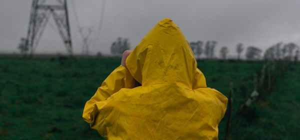person wearing yellow raincoat