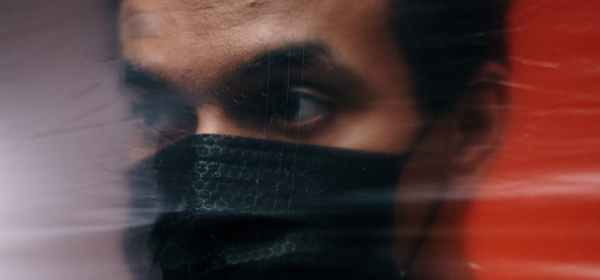 man wearing a black face mask