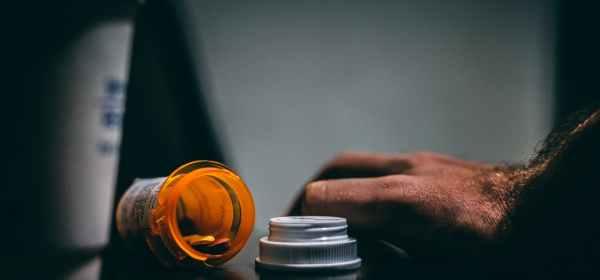 orange and white prescription bottle on table