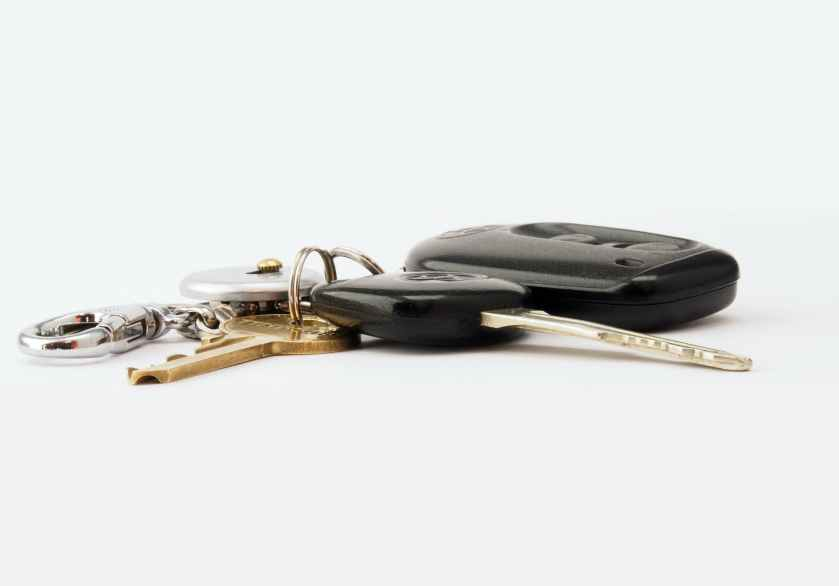 two black and brass colored keys with fob