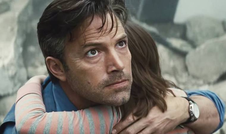 Bruce Wayne (Ben Affleck) after saving a girl from a falling piece of Wayne Tower