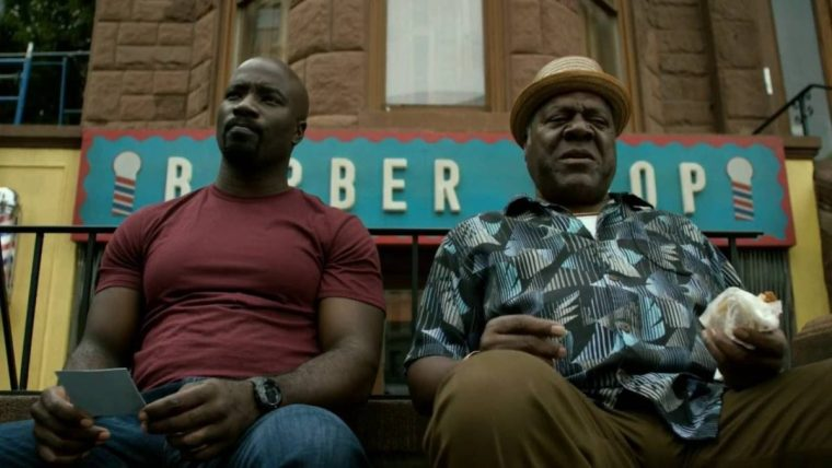 Luke (Mike Colter) and Pops (Frankie Faison) in front of Pops' Barbershop (Luke Cage, Netflix)