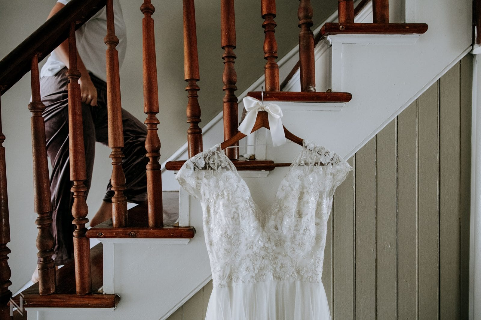 wedding photography in Old St. Charles, Missouri as mother helps bride into lacy and tulle wedding gown