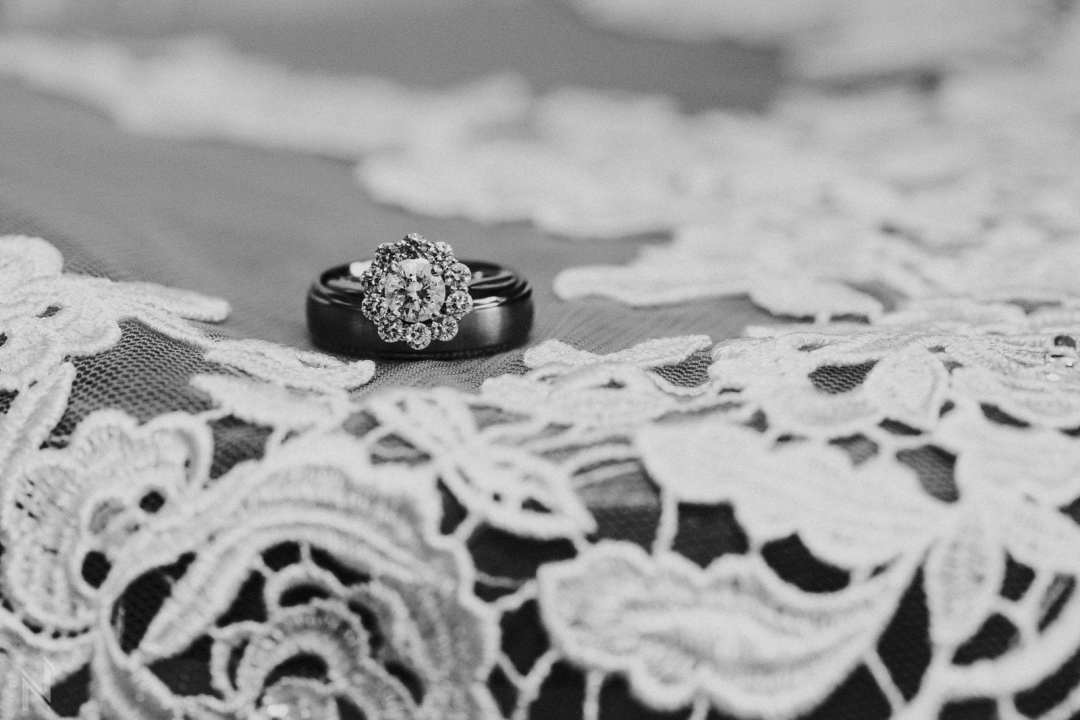 Bride's flower shaped engagement ring and lace dress in St. Louis, MO, home