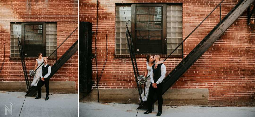 Bride and groom being photographed in Downtown Clayton, MO, after their wedding