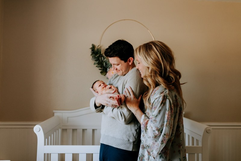 authentic lifestyle newborn family photography in home St. Louis Missouri with puppy
