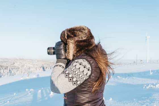 Photographer in a winter landscape