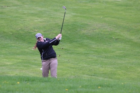 Charles City's Emma Williams hits out of the rough Tuesday during Charles City's home golf meet at Cedar Ridge Golf Course. (Photo by Chris Baldus