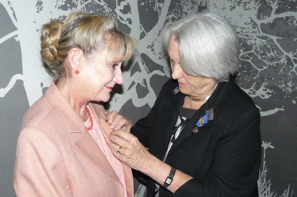Past-President-Janet-Callard-(right)-pinning-the-president-lapel-to-President-Ann-Coral-Stewart-(left)