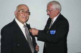 Zorba-Miltiadou-(left)-receiving-the-Paul-Harris-fellowship-award-by-District-Governor-Charles-Deiner-(right)
