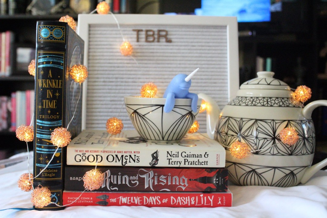 my December TBR-good omens-ruin-and-rising-a wrinkle in time-the twelve days of Dash and lily-tea