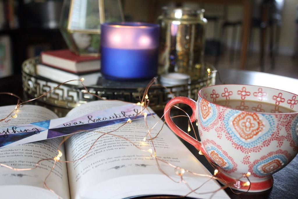 weekend-reading-coffee-candle-fairy-lights-bookmark-book