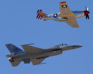 A P-51 Mustang (top) and F-16 Fighting Falcon fly together during the Heritage Flight Conference here March 5. The annual aerial demonstration training event has been held at D-M since 2001, providing civilian and military pilots the opportunity to practice formation flying in advance of the upcoming air show season. (U.S. Air Force photo/Staff Sgt. Jacqueline Romero) (RELEASED)