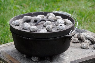 Dutch oven with charcoal on the lid