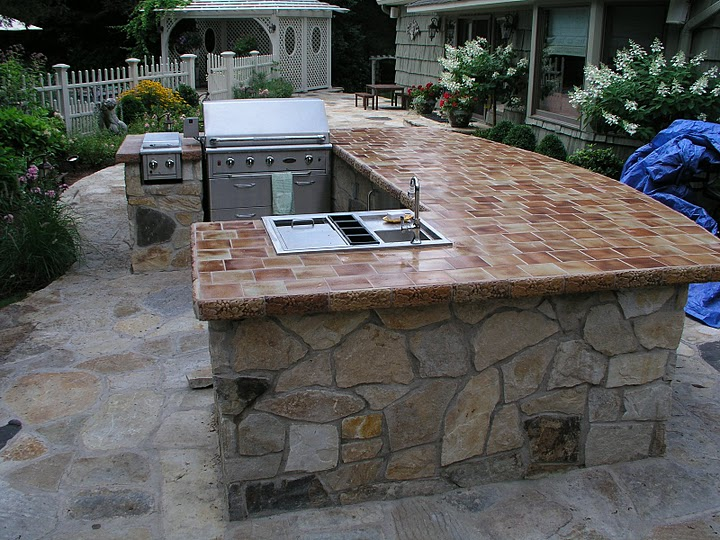 an outdoor cooking island and bbq