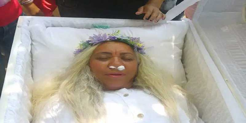 Bizarre Ceremony: Mayra Alonzo of santiago rehearses for her own funeral