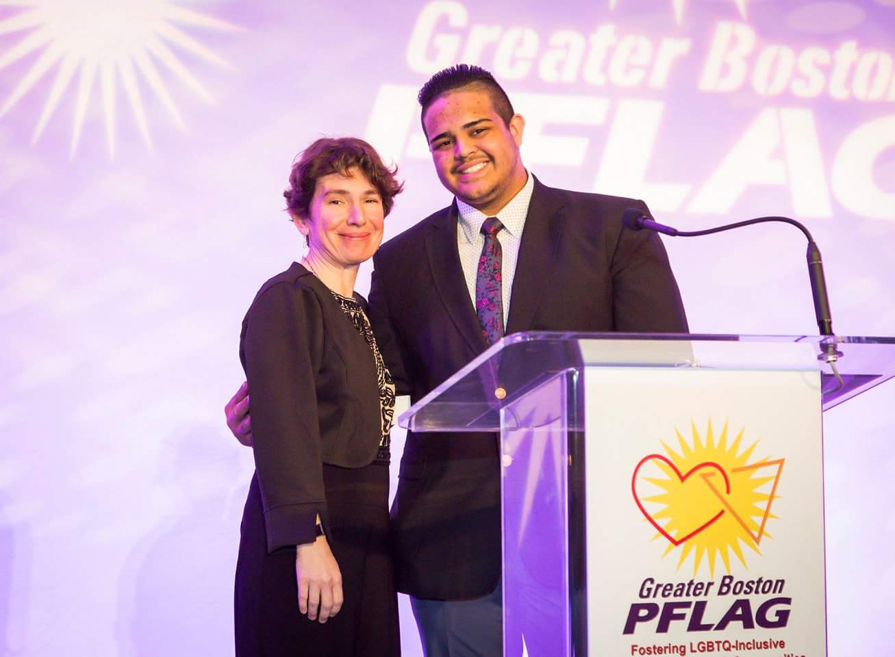 Left to right: Executive Director of Greater Boston PFLAG Valerie Frias and Northeast Metro Tech senior Christian DeJesus Franco at the Greater Boston PFLAG's Pride and Passion dinner. (Courtesy Photo Northeast Metro Tech)