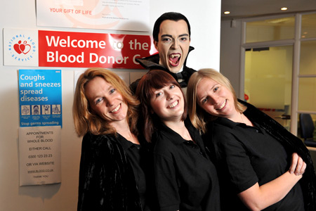 Dracula with three brave members of the NBT Communications team (Photo: Brian Slater)