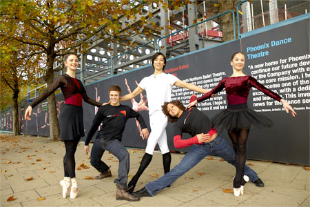 Northern Ballet Theatre and Phoenix Dance Theatre Dancers in front of the new hoardings