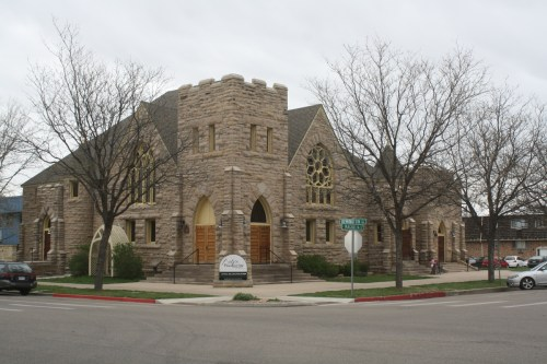 The First Baptist congregation built this stone structure in 1903-04, replacing a smaller brick church building. An addition on the east side was added in 1912. There also used to be a steeple which was probably removed in the 1940s.