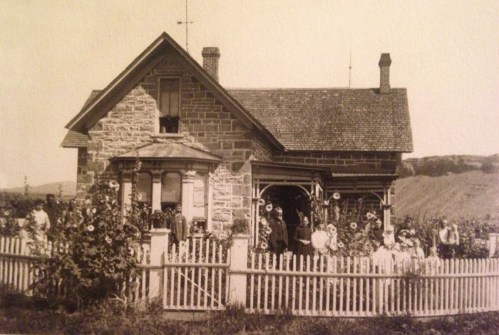 The Flowers house. From left to right are: Adelaide (Obenchain) Flowers, Thornton Wesley Flowers, Charles Pennock, Ben Flowers, Jacob Flowers, Elizabeth Flowers, Lydia (holding baby), possibly Cora Flowers Tilton, unidentified children, Salvina Flowers Beach, the Beach children, and probably Jeremiah Beach. (Photo thanks to Judy Jackson.)