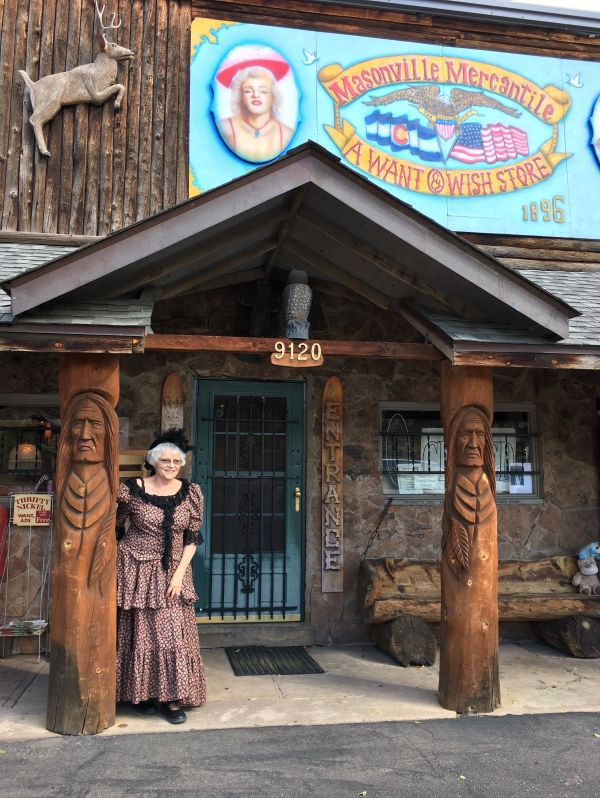 Mardi Denny poses in front of the Masonville Mercantile -- October 2016.