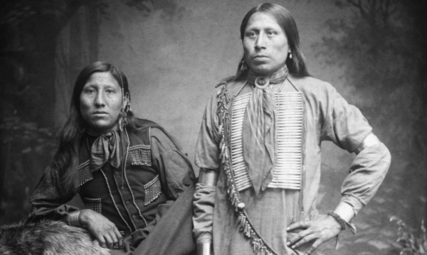 Changing Crow (seated) and companion -- both Dakota Indians. (Photo from the Denver Library Archive, X-31827.)