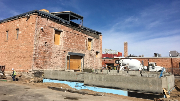 The Dunham-Akin warehouse with the foundation of the new building that's being constructed. (Photo taken on March 15, 2017.)
