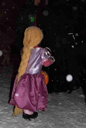 Penny as Rapunzel a few years ago trunk-or-treating in a blizzard.