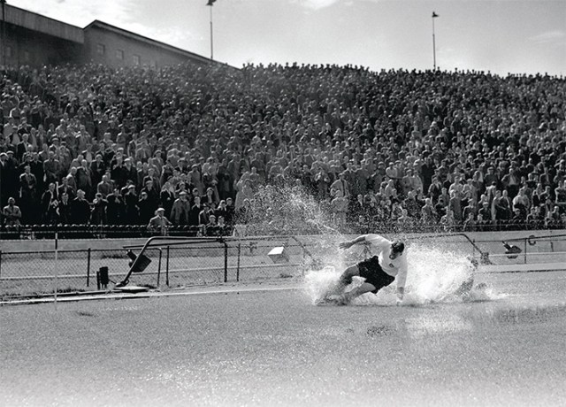 Tom Finney splashes through a puddle for Preston Norther End v Chelsea at Stamford Bridge in 1956