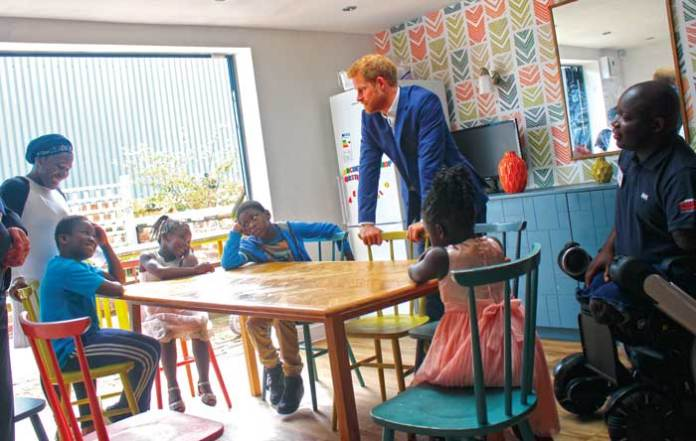 Prince Harry visits the home of Lamin Manneh