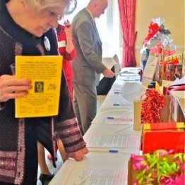 Silent Auction items get looked over by past President Judith Albert and VP Greg Polyak at the Northern Ohio Opera League's Post Valentine Brunch at the Shaker Country Club 2.16.14