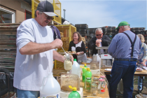 Tom Kruel of Flanders loads up a jar with the pungent elixir.