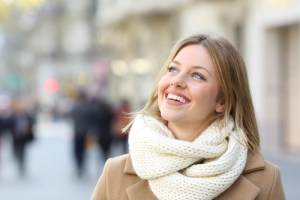 Woman in city smiling
