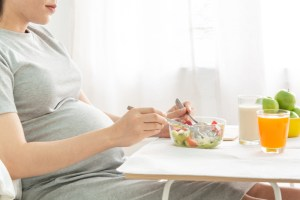 pregnant woman eating healthy super foods