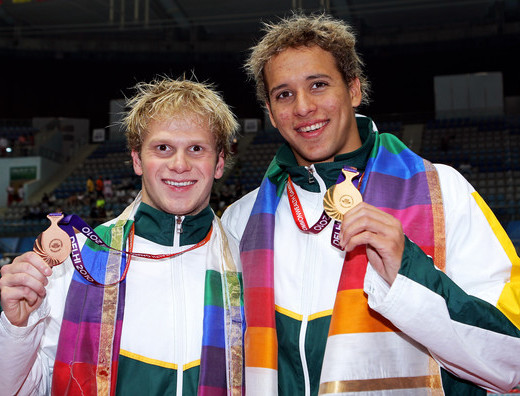 Henri's brother, Riaan with Chad le Clos at the Dehli Commonwealth Games in 2010. PHOTO: an Walton (Getty Images AsiaPac)