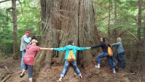 Friends of Willapa hugging a tree.