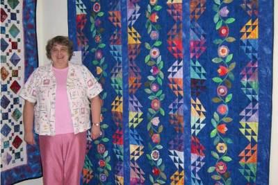 Carolann with her quilt
