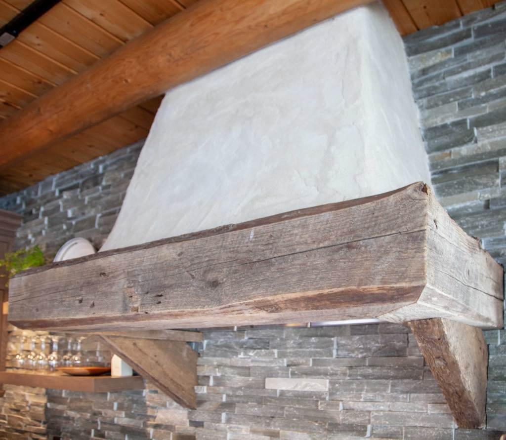 custom plaster hood with reclaimed wood beam mantel