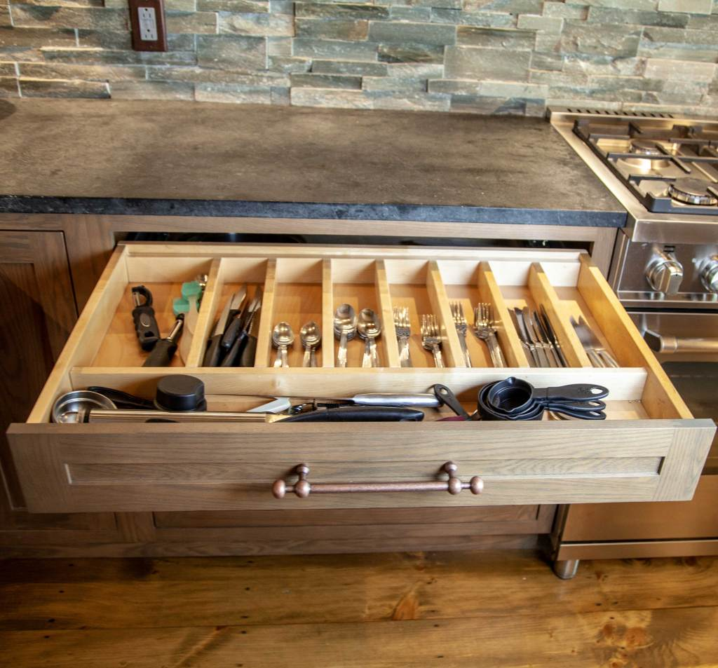 kitchen remodel featuring a custom wood cutlery divider