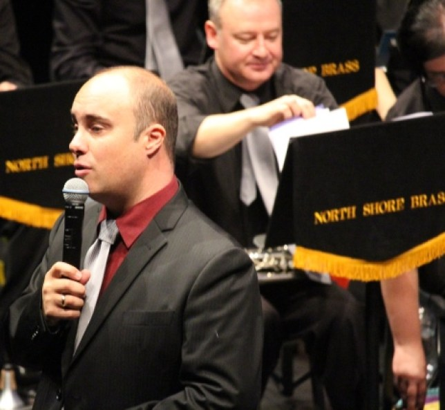 Musical Director Colin Clark distracts the audience while Principal Cornet John Sullivan finds the next piece