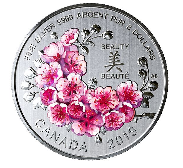 reverse of silver coin with coloured cherry blossoms