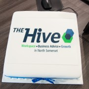Square cake with The Hive logo