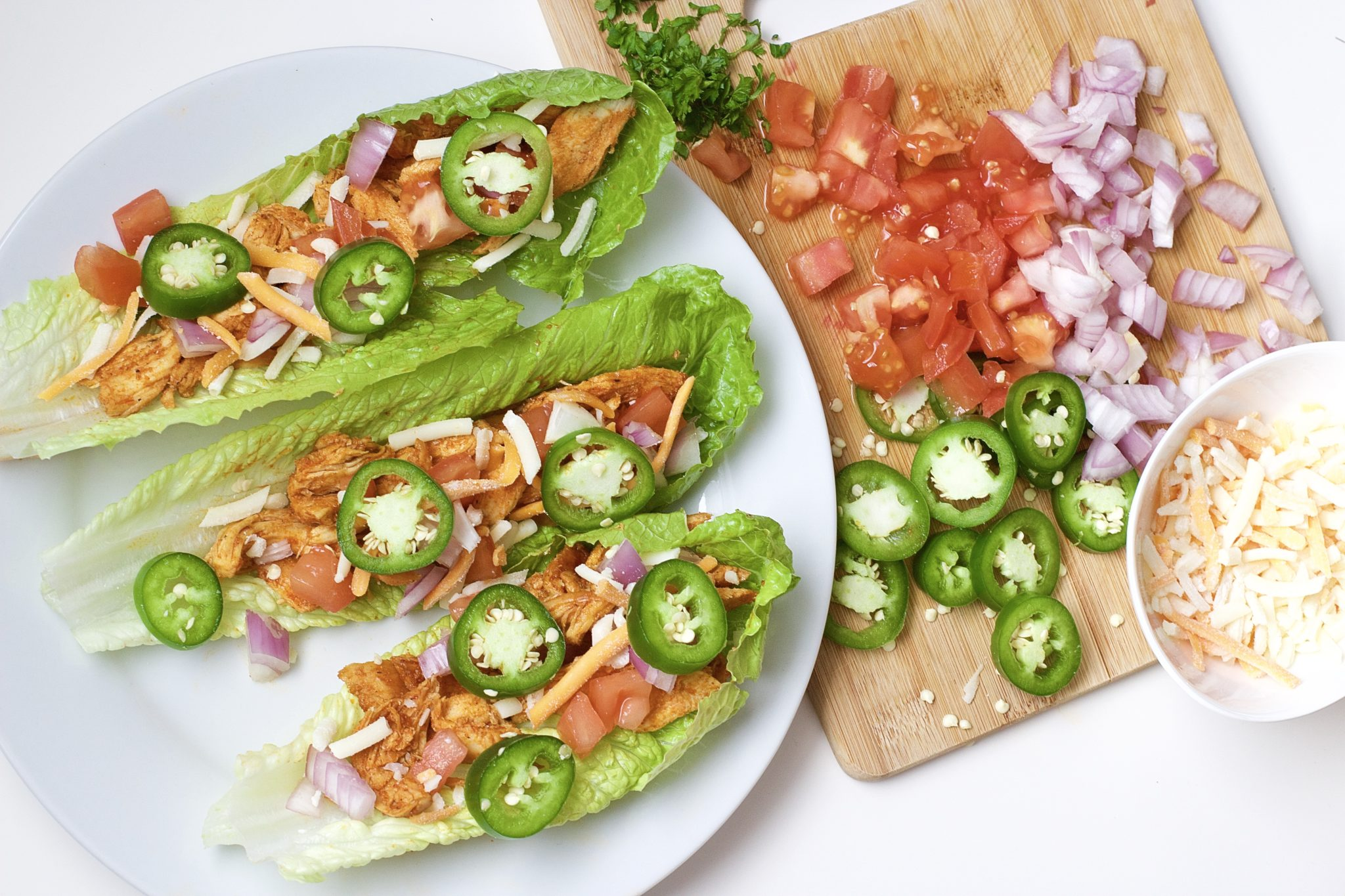 Light, crispy and delicious Buffalo Chicken Lettuce Tacos are made in 20 minutes or less. An easy, gluten-free, low carb, keto and paleo recipe. Enjoy the wraps as an appetizer or main dish. Mexican Recipes | Lettuce Tacos | Chicken Tacos | Spicy | Hot Sauce | Summer Recipe | Game Night | Date Night | Dinner | Low Carb | Ketogenic | Keto | Weight Loss | Buffalo Chicken | Paleo | Easy Dinner | Salad | Romain Lettuce | Lettuce Taco Shells | Lettuce Wraps |