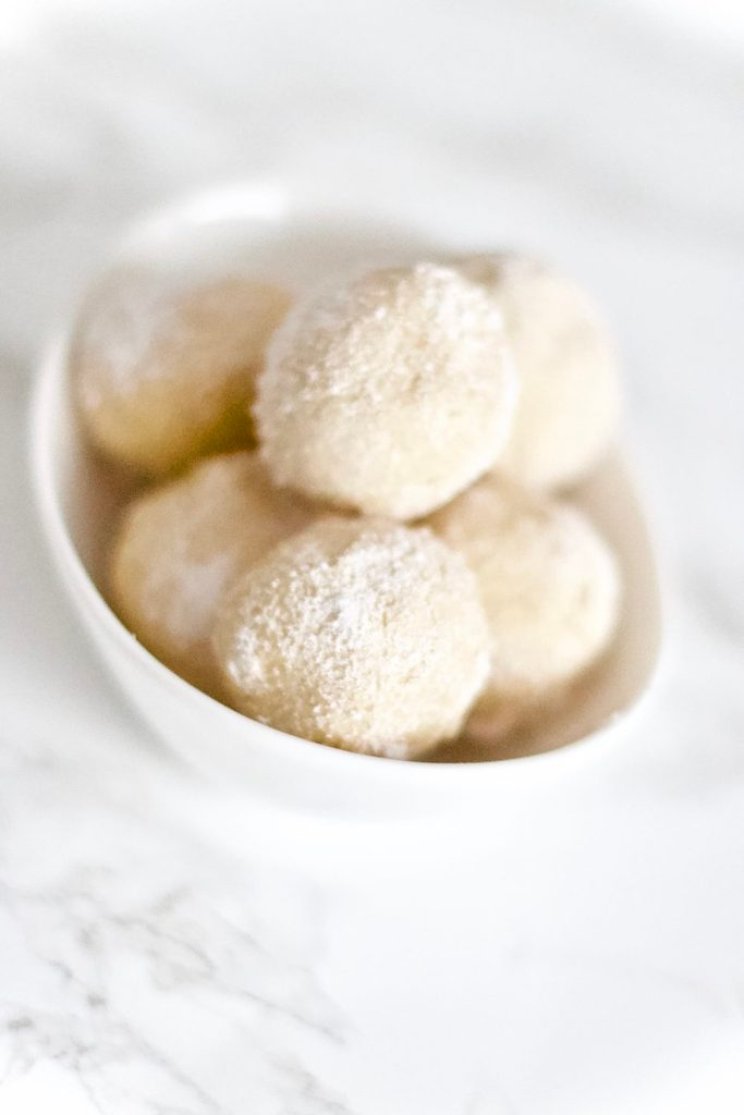 Stay in ketosis this Christmas with these frosted cheesecake fat bombs. They're absolutely scrumptious, easy to make, low carb, sugar free, and gluten-free! 3 Ingredients | Keto Desserts | Dessert Recipe | Low Carb | Weight Loss | High Fat | Healthy Fats | Keto Friendly | No Bake | Frozen | Peanut Butter | Treat | Balls | Sugar Free | Gluten Free | Holiday Recipes | Christmas Dessert | Christmas Recipe | Snow | Snowball | Easy Recipes | Keto Snacks | Bite Sized |