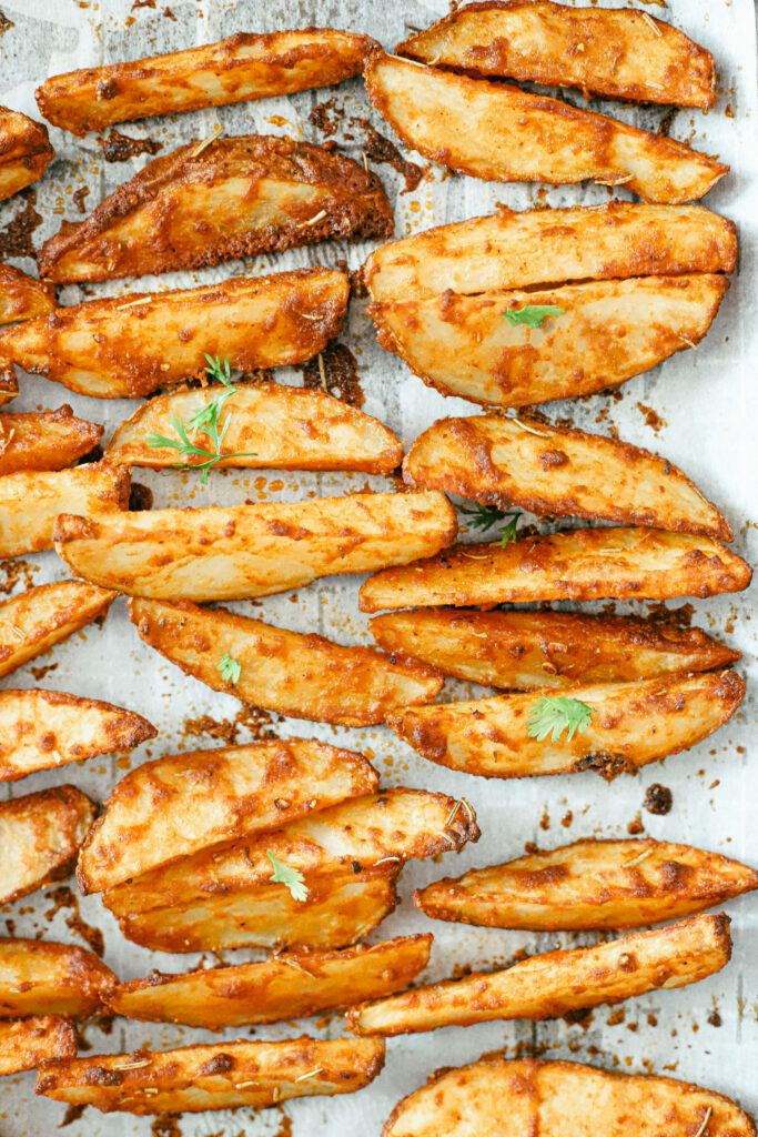 The best parmesan crusted wedges with seasoned roasted potatoes, freshly cut to perfection for the perfect dinner side dish or snack. Gluten-Free | Potato Side Dishes | Fresh Cut Fries | Potato Wedges | Rosemary | Seasoned Potatoes | Homemade Wedges | Baked Potato Wedges | Crispy Potatoes | Comfort Food | Potato Recipe | Appetizer |