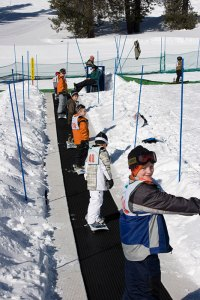 Young students ride Mount Shasta Ski Park's Magic Carpet
